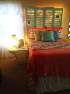 DIY bedroom shutter headboard. Christmas lights in headboard