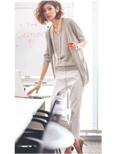 Monochrome. White trousers outfit with gray top and cardigan