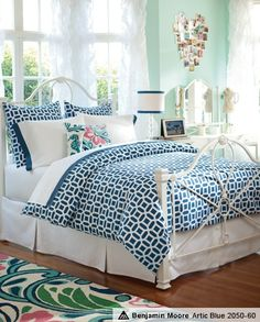 Love the usage of various shades of blue  different patterns making this interesting  soothing- love this for a teen bedroom