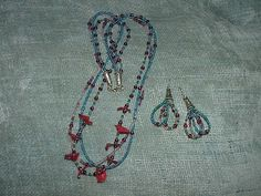 Three strand beaded necklace and earrings