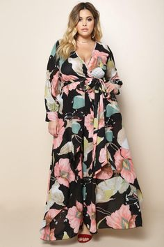 A plus size maxi dress with a V neckline, surplice bodice, long cuffed sleeves, a self-tie belt around the waist, and layered comfort fit skirt. Art nouveau inspired floral print allover and finished hem.