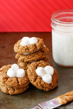 Flourless Fluffernutter Cookies - this easy peanut butter cookie recipe is turned into thumbprints that are filled with marshmallows. Inspired by fluffernutters, these cookies will be a family favorite and they are naturally gluten free. #cupcakesandkalechips #fluffernutter #peanutbutter #peanutbuttercookies #glutenfree #glutenfreebaking #glutenfreecookies #marshmallows #kidfavorite