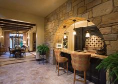 View from Tuscan home's Family Room toward Bar, Casual Dining room & Kitchen...