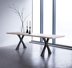 Our Exe dining table - a table for all occasions. With a solid wooden top spanning two elegant steel crosses it's a modern take on an old refectory table, ideal for family life. Wooden Table Top, Wooden Dining Tables, Modern Dining Table, Dining Rooms, Pedestal Tables, Dinning Table, Round Dining, Fine Dining, Dining Area