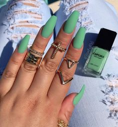Gold goes great with these matte sea green nail polish.