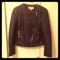 Michael Kors Quilted Leather Moto Jacket Dark NAVY (not black) Soft, supple quilted leather and gold zipper hardware. Back and side panels are knit ponte material.  Very tailored fit (8-10).  Beautiful jacket...worn once. Michael Kors Jackets & Coats