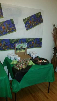 The table with cups of treats... Green Apple sauce and gummy worms, mints, skittles,  etc