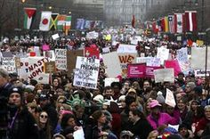 Thousands of protesters fill the Benjamin Franklin Parkway as they participate in a Women's March in Philadelphia