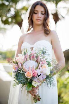 King Protea, succulent, gardenia, orchid, eryngium, ginger bridal bouquet. www.halatropicalflowers.com