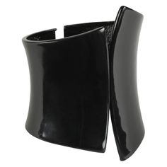 SCHOOF - Black patent cuff. Another accessory find at www.aldoshoes.com. This looks even more expensive in person, and different then the silver and gold cuffs everywhere. 15.00 at ALDO.