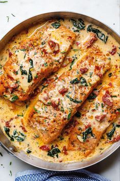 - Smothered in a luscious garlic butter spinach and sun-dried tomato cream sauce, this Tuscan salmon recipe is so easy, quick, and simple. - by Creamy Garlic Tuscan Salmon With Spinach and Sun-Dried Tomatoes - Salmon Dishes, Fish Dishes, Seafood Dishes, Salmon Meals, Seafood Stew, Tuscan Salmon Recipe, Low Carb Recipes, Healthy Recipes, Vegetarian Recipes
