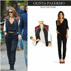 Olivia Palermo in black belted jumpsuit with colorblock bomber varsity jacket