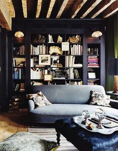 Living room with dark cool colors | Ilse Crawford