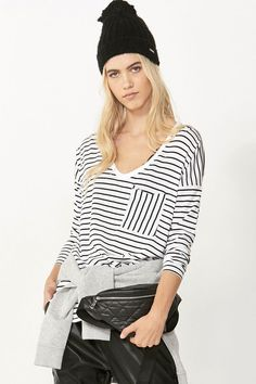 A soft cotton blend with a relaxed oversized silhouette, full length fitted sleeves, a scoop neck and a hi-low hemline. Style with drop crotch pants. Choose regular size for comfy oversized look. Luxe Clothing, Drop Crotch Pants, Boyfriend Tee, Color Stripes, Perfect Fit, Street Wear, Girl Outfits, Bell Sleeve Top, Clothes For Women