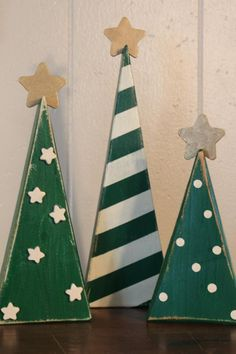 These trees are hand painted by me, distressed to look antique, and sealed for protection. The colors are Christmas green and antique white, with gold stars on the top of the trees. One tree has small antique white stars Wooden Christmas Decorations, Pallet Christmas Tree, Christmas Wood Crafts, Christmas Signs, Rustic Christmas, Christmas Projects, Winter Christmas, Holiday Crafts, Christmas Trees