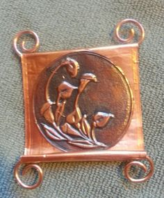 Another embossed copper piece