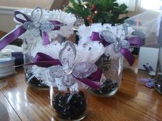 Mason jar butterfly centerpieces - perfect! Not as frilly, and with bright/fun ribbon