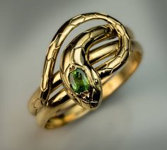 Antique Demantoid Gold Snake Ring   From a unique collection of vintage more rings at https://www.1stdibs.com/jewelry/rings/more-rings/ #GoldJewelleryUnique #jewelryrings