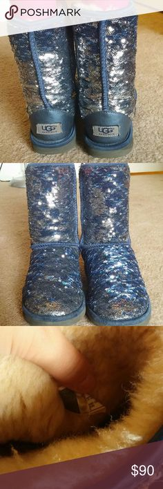 Adorable uggs!!! Super cute navy/silver uggs! Color can switch depending on which side of the sequin is showing! No water marks or stains! The inside and bottoms are in great shape :) perfect for fall! UGG Shoes Winter & Rain Boots