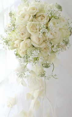 A pretty wedding bouquet of white roses and baby's breath. Summer Wedding Bouquets, Bride Bouquets, Flower Bouquet Wedding, Floral Wedding, Purple Bouquets, Bridesmaid Bouquets, Pink Bouquet, Brooch Bouquets, Flower Bouquets
