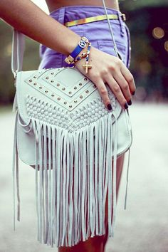 Fringe bags are a must-have for any boho-style fashionista. They are flirty, playful and make a great addition to any summer outfit.