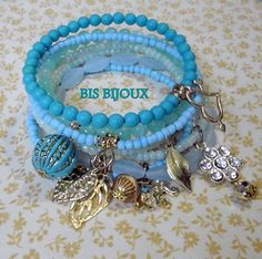 Handmade bracelet They sell these coil bracelets and then you add beads and charms. Memory Wire Bracelets, Handmade Bracelets, Jewelry Bracelets, Handmade Jewelry, Blue Bracelets, Ankle Bracelets, Make Your Own Jewelry, Jewelry Making, Bling Bling