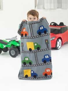 This knit Traffic Throw will make a perfect match with that car shaped bed they love to sleep in.