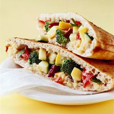 Chopped salad in pocket  Summer squash, broccoli, and tomatoes are tossed with dressing and put in a hummus-lined pita for this vegetarian sandwich recipe.