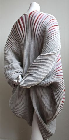 """ISSEY MIYAKE seashell coat , 1985 - """"...with a heat-pleating post-process that coincides with the bands of color in the initial knit design"""""""