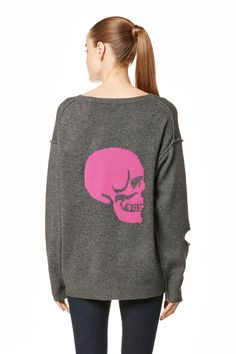 A smattering of holes adorn this slouchy, grunge-inspired style, complete with a skull print on the back. Center-front seamed detail. Dropped shoulders. Slight high-low hem. Ribbed trim. Fabric: 70% wool / 30% cashmere. Fit: True to size. Relaxed.