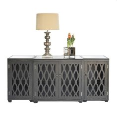 Media Console. Love the shape and lines, I think I however would like it in a bright orange or red. Love the lamp on it as well.