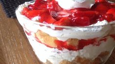 Angel food cake pieces are topped with sweetened cream cheese, whipped topping and strawberries in this chilled, layered dessert.