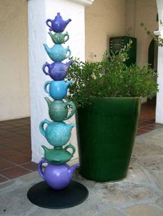 Fox & Lois Garney - Clay Arts Gallery, Amphora, CA . could be the totem for a tea shoppe . Garden Totems, Glass Garden Art, Glass Art, Garden Crafts, Garden Projects, Garden Whimsy, Flower Plates, Outdoor Art, Garden Ornaments