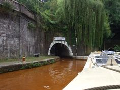 The entrance to Harecastle Tunnel, iron deposits turn the water orange.