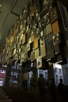 Wall of speakers in a clothing store