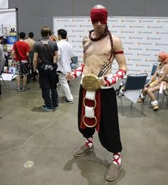 Somehow, Lee Sin makes wearing a red blindfold look extremely badass. | The 21 Most Important Shirtless Men At Anime Expo