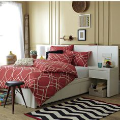 Love beds with storage! So much easier than just stuffing everything underneath.