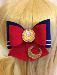 This is my own representation of the sailor scout Sailor Moon from the show Sailor Moon. Perfect addition to any Sailor Moon outfit or cosplay. Bow design is based off the original anime outfits. The hair bow is 3 1/2 x 3 and attached to an alligator clip. Cabochon is hand designed.  I currently have available the first season scouts but I take requests for the other scouts as well. They are also on my list to do in the future. You can find the other available scouts by following these l...