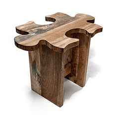 Jigsaw Puzzle Stools. Hand-carved in India of mango wood, the interlocking puzzle stool can be used as an occasional table, extra seating, or a fun accent piece. And because you can group together as many as you like, you can form your own unique piece of furniture. $495.00