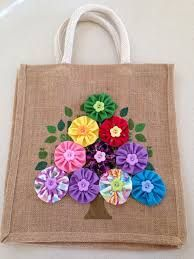 Hessian bag with flowers. A DIY way to add some colour and flare to a re-usable . Hessian bag with flowers. A DIY way to add some colour and flare to a re-usable hessian bag. Hessian Bags, Jute Bags, Patchwork Bags, Quilted Bag, Patchwork Fabric, Fabric Bags, Fabric Scraps, Sewing Crafts, Sewing Projects