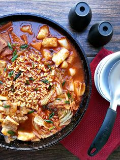 Korean army base stew also known as budae jjigae is a hodgepodge of delicious ingredients from ramen noodles to rice cakes to spam to kimchi and vegetables.