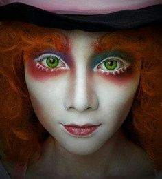 Mad hatter make up. Not sure how the white will translate on stage.