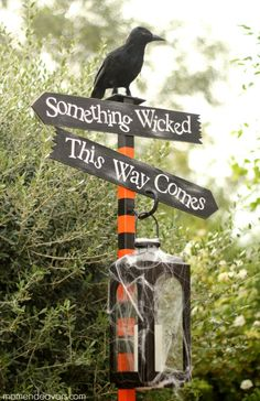 """Something wicked this way comes"" - Great DIY Halloween spooky lantern sign post!"