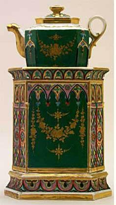 Teapot #376  Hexagonal with conforming pot, two large panels, green and gold garlands, four narrow end panels, variegated colors and gay as is base and top portion of stand. See No. 19.  Acquired in Nimes