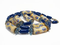 Vintage Millefiori Glass Necklace, Cobalt Blue, Glass Flower Spacers, Yellow Glass, 33 Inch, Vintage Jewelry, Murano Glass, Necklace by VintageGemz on Etsy https://www.etsy.com/listing/496757244/vintage-millefiori-glass-necklace-cobalt