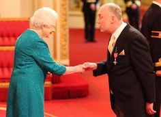 Disabled travel hero David Partington receives MBE from Queen (From The Bolton News)