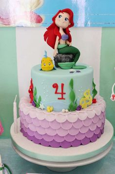 Amazing cake at a Little Mermaid birthday party! See more party planning ideas at CatchMyParty.com!