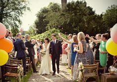 outdoor garden wedding ceremony | Photo by Marianne Taylor
