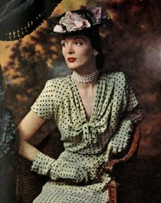 1945 March issue of Ladies Home Journal.  Rose Barrack design polka-dots dress and matching gloves.