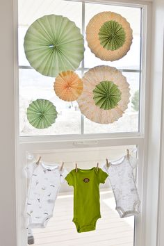 Paper flowers and onesies for the baby shower window decoration. Easy and fun.